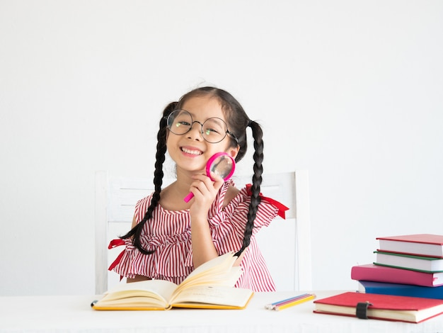 Asian cute girl with book on the desk