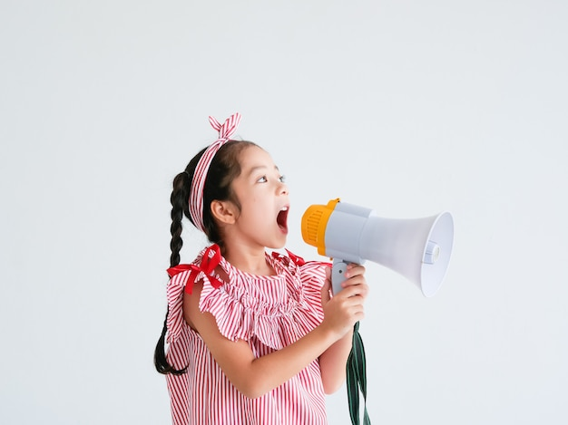 Asian cute girl with megaphone singing