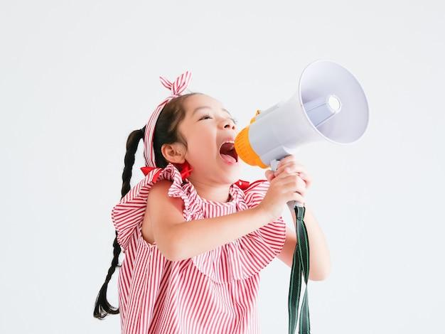 Asian cute girl with megaphone singing