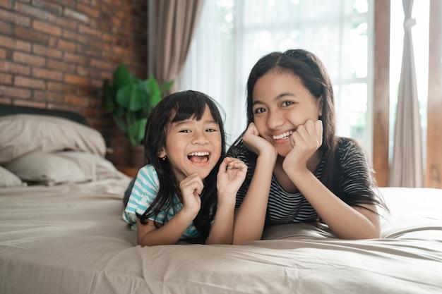 Asian cute happy sisters smiling