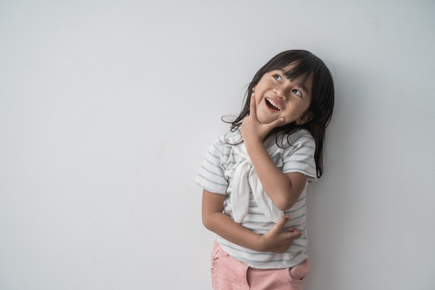 Asian cute little girl surprised looking up