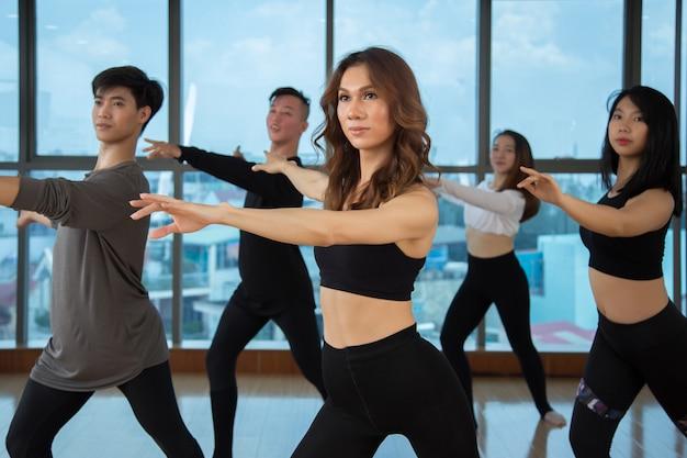Asian dancers training in studio