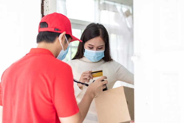 Asian delivery man deliver coffee and food to young woman customer