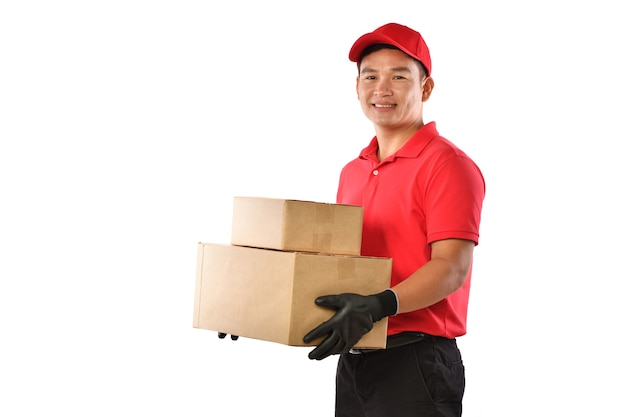 Asian delivery man in red uniform with parcel cardboard box isolated on white