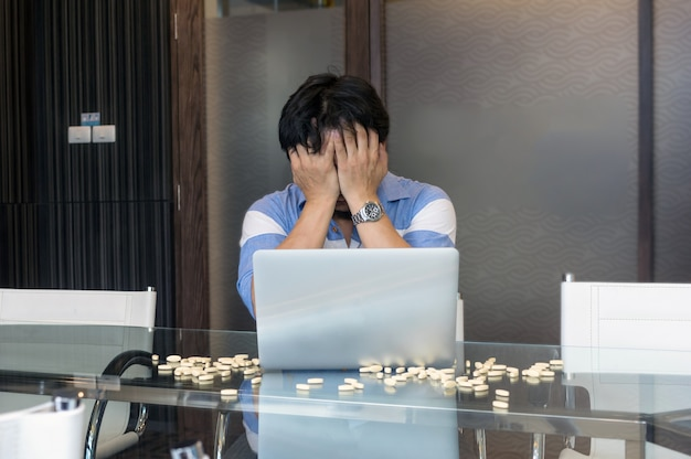 Asian depressed businessman in seriuos action while working