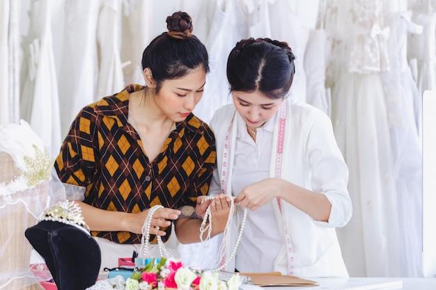 Asian designer working in wedding fashion store shop