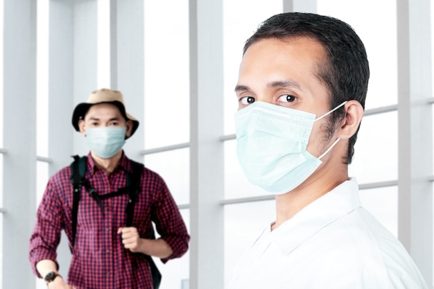 Asian doctor checking man health before traveling in the hospital. medical check up before traveling