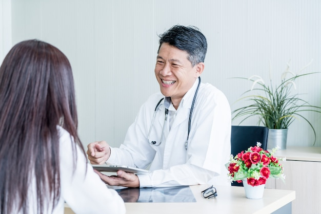 Asian doctor and patient are discussing