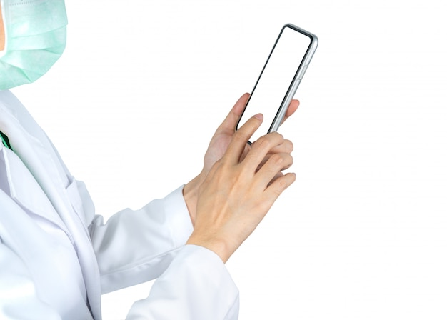 Asian doctor use mobile phone to communicate with nurse or healthcare providers to consult about patients information in hospital. woman's hand holding and using smartphone.