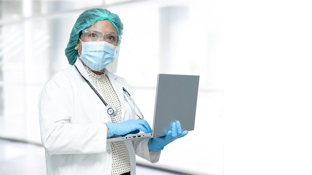 Asian doctor wearing ppe suit to protect covid-19 coronavirus.