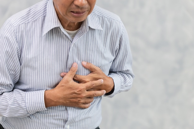 Asian elder suffer from chest pain from heart attack or stroke.
