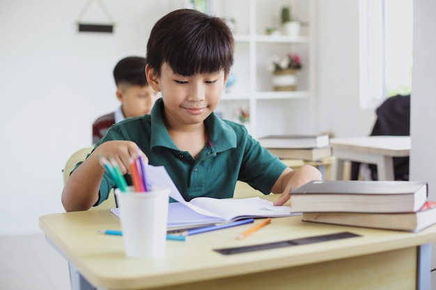 Asian elementary school boy studying in the class