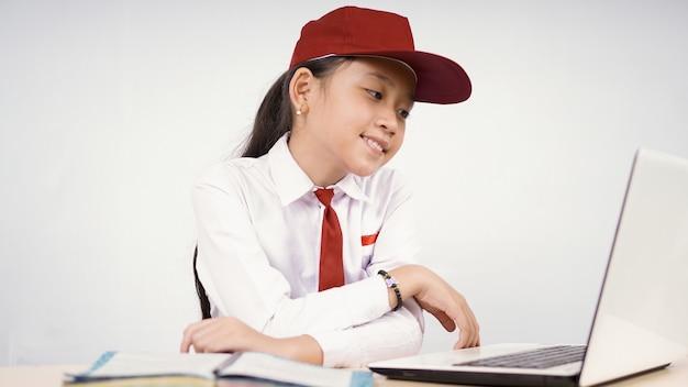 Asian elementary school girl studying enjoy isolated on white background