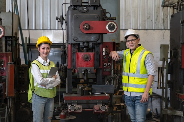 Asian engineer checking production process on factory station. industrial concept