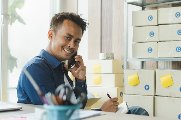 Asian entrepreneur reviewing checklist.