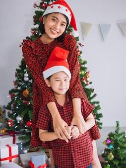 Asian family celebrating christmas in house