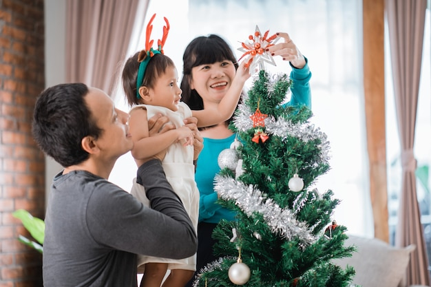 Asian family preparing for christmas together