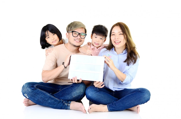Asian family with blank paper