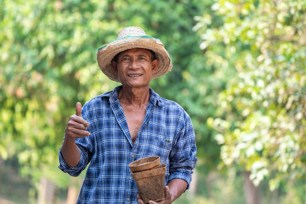 Asian farmer agriculture holding pot.