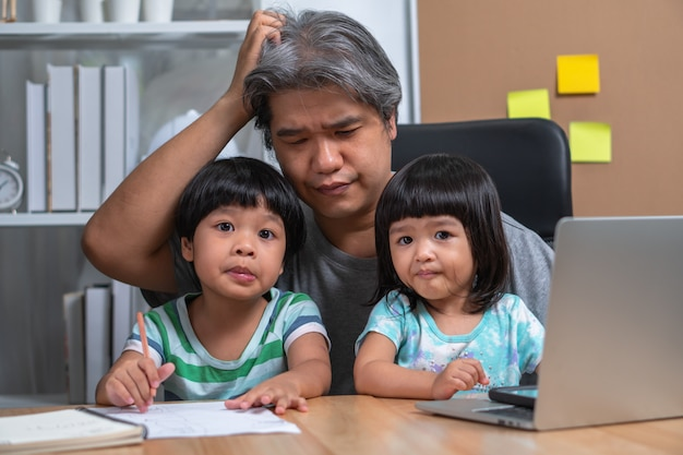 Asian father attempt to work at the home office with a daughter who came into chaos.
