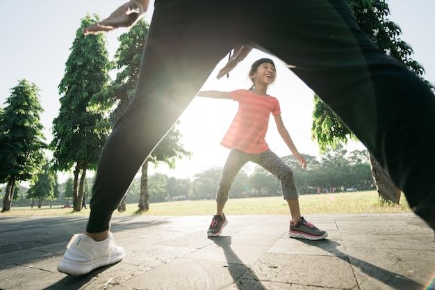 Asian father and daughter do exercises catch and play together