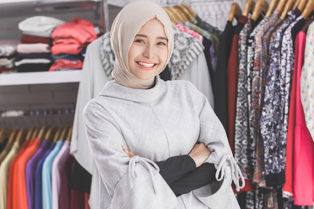 Asian female boutique fashion store owner
