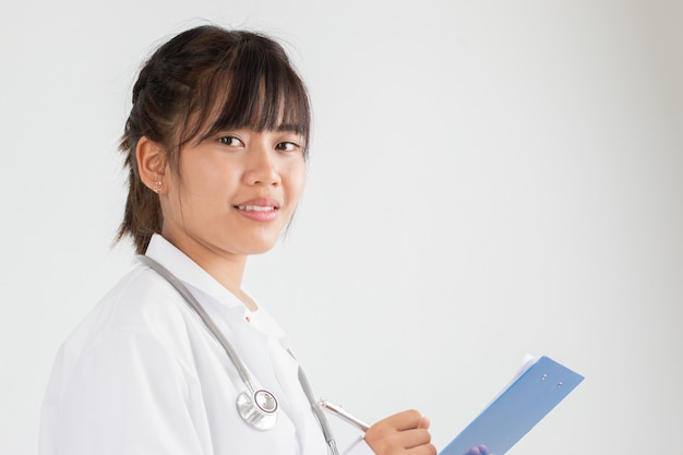 Asian female doctor medical physician with prescription clipboard with record paper