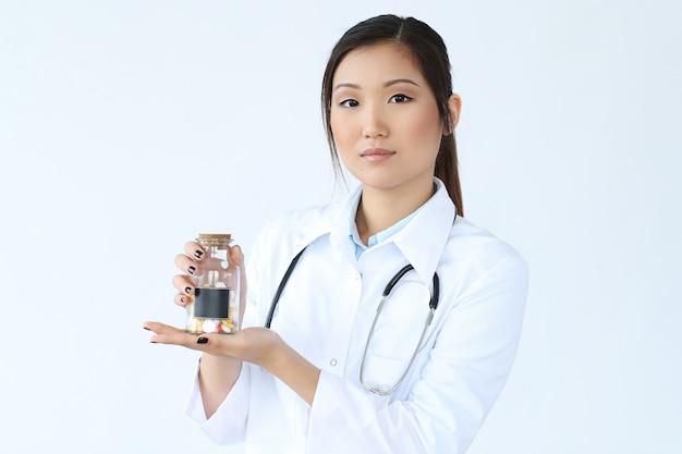 Asian female doctor posing, medicine specialist