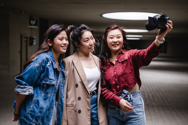 Asian female friends bloggers creating content for social media