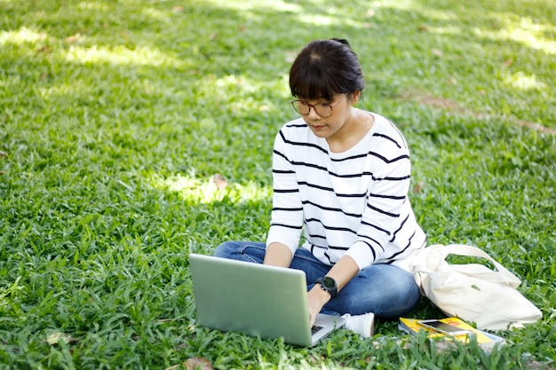 Asian female student doing the homework with diligence