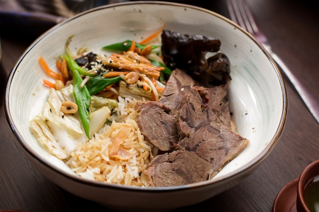 Asian food: beef with rice and greens