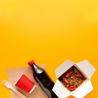 Asian food box with yellow background