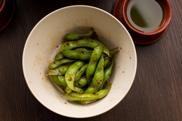 Asian food: pea pods with red pepper