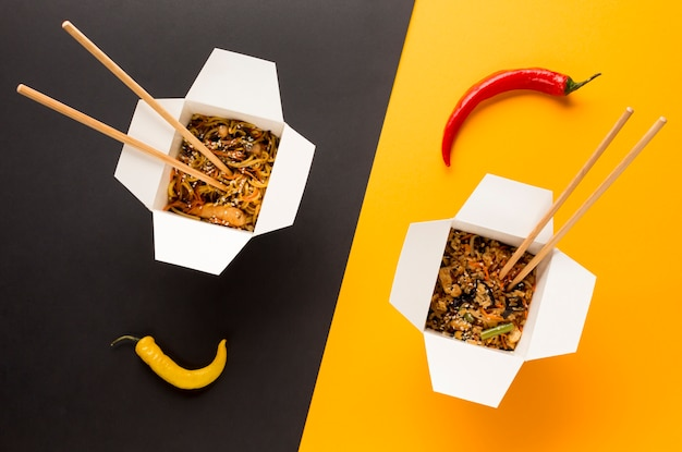 Asian food with chopsticks top view