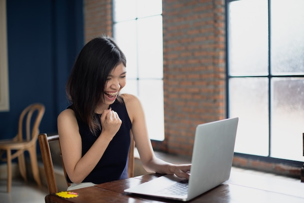 Asian freelance girl feeling happiness with her work.