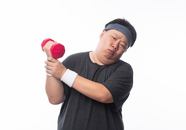 Asian funny fat man in sport outfits exercising with dumbbells