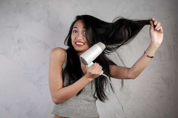 Asian girl blowing her hair