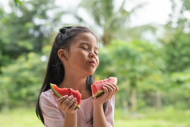 Asian girl eating watermelon