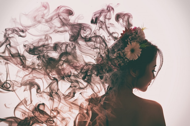 Asian girl is beautiful and charming with flowers crown. she is evaporating into perfume smoke. flare light style.