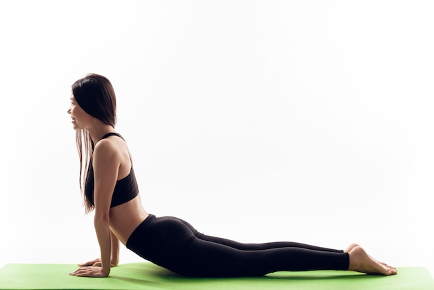 Asian girl is doing back stretching exercises.