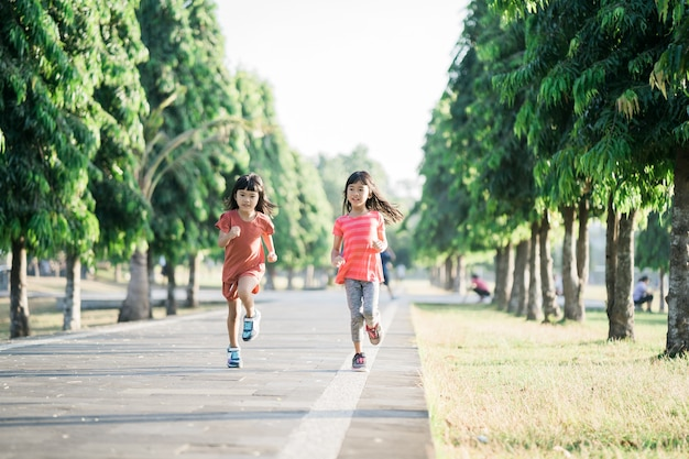 Asian girl is jogging in the park in the morning
