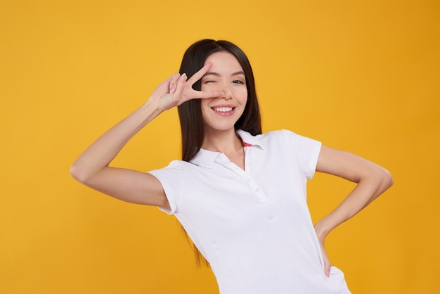 Asian girl is posing playfully isolated.