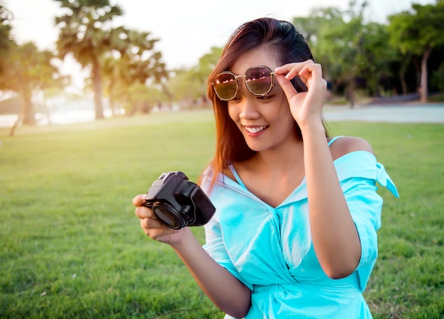 Asian girl look digital camera