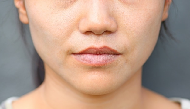 Asian girl mouth close up.