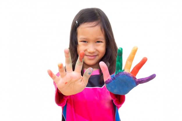Asian girl painting color on left hand and finger. art activity.
