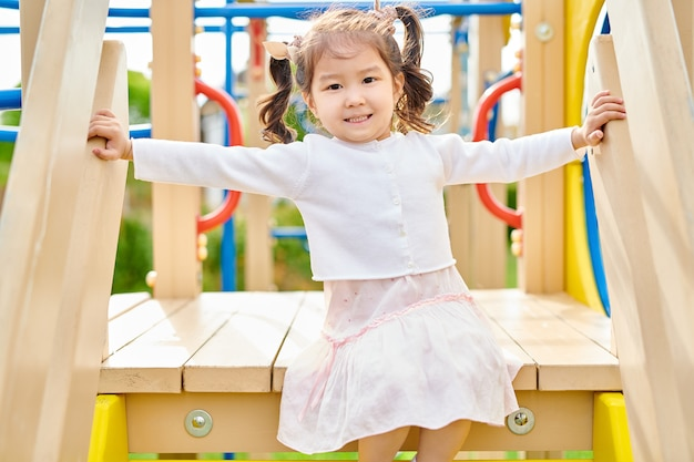 Asian girl on playground