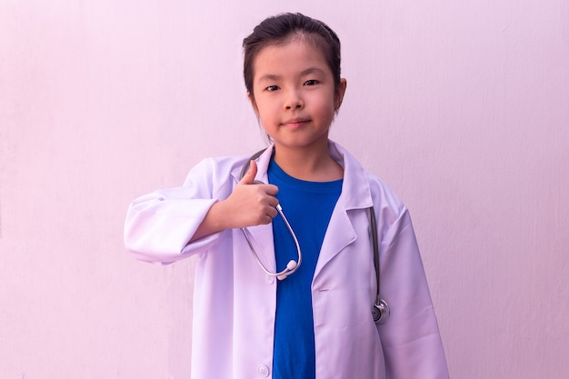 Asian girl playing doctor with stethoscope