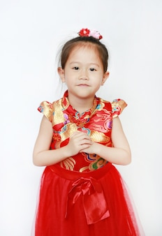 Asian girl in red cheongsam greeting gesture