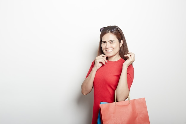 Asian girl in red dress with shopping bags