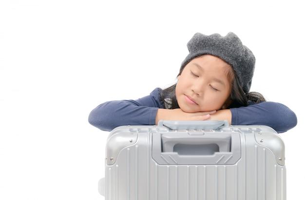 Asian girl sleep on baggage wait plane isolated